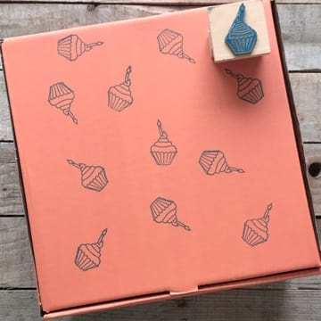Reuse the box as a gift box by turning it inside out and decorating it with an ink stamp