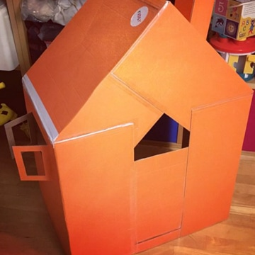 Use a couple of big boxes to make a playhouse complete with door and windows
